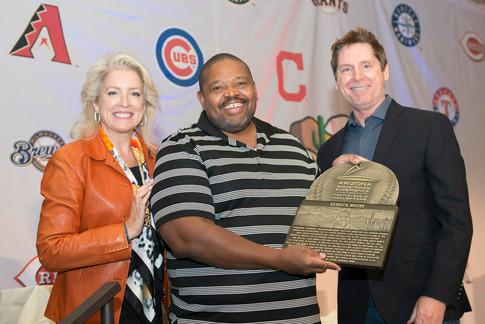 Presenter Jaime Rupert, Inductee Derrick Moore, and Cactus League Hall of Fame Director Tim Sheridan