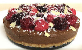 Raw chocolate tart with avocado and berries