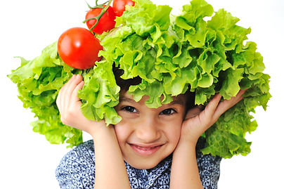 Kid with salad and tomato hat on his head, fake hair made of vegetables.jpg