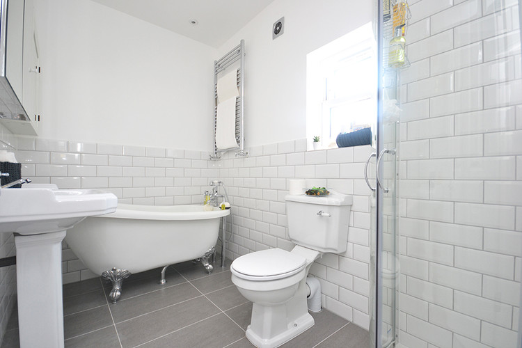 white and spacious 3 piece bathroom.jpg