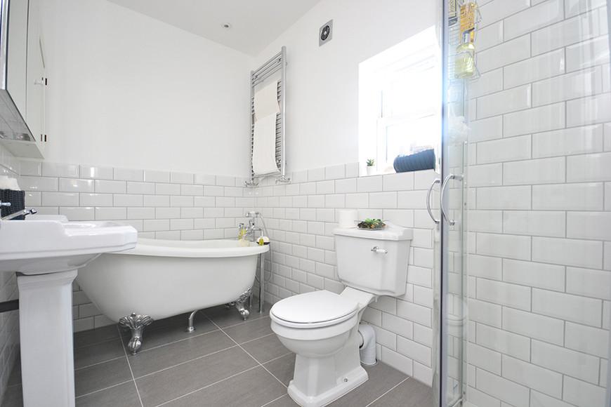 white and spacious 3 piece bathroom.jpg