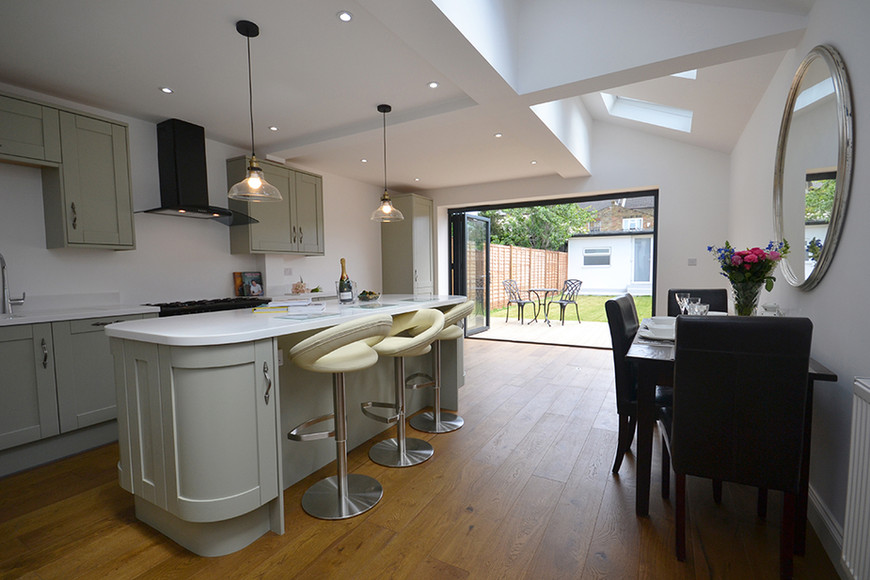 large kitchen with breakfast bar home fo