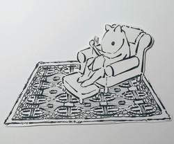 Joel sewing in his living room