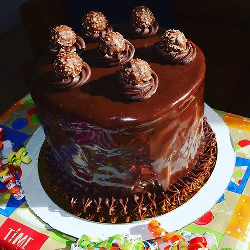 4 Layer Cake w/ Chocolate Glaze and Ferrero Rocher Candies