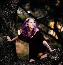 chrissy climbing tree.jpg