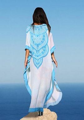 White Kaftan in silk. Dazzling sapphire blue necklace. Versailles