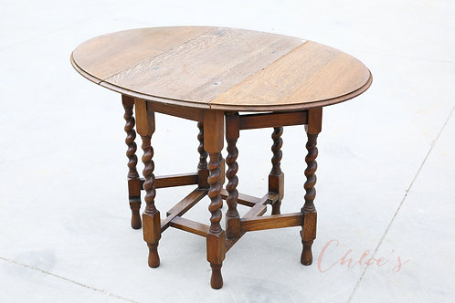 Twist gate leg table