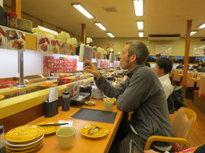 Charley ordering sushi in Japan