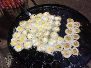 Fried quails eggs are a popular street snack in Thailand