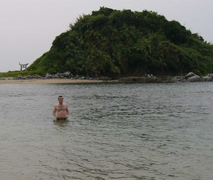 Charley wading to a Japanese islet. The water got much deeper, very quickly!