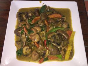 Portobello mushrooms in a green curry sauce