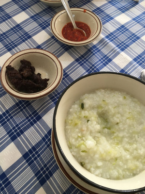 Malagasy food is often simple but tasty. Here's a breakfast of rice with greens, kitoza (fried meat), and chili sauce (sakay)