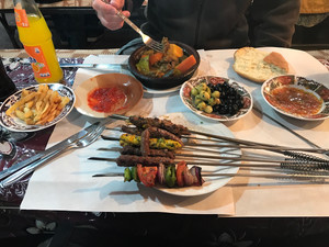 Moroccan feast: kebabs, olives, and even some french fries