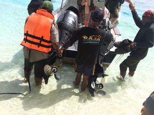Splashing ashore on Merpati Island