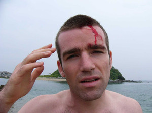 Charley banged his head on a Japanese islet, then had to swim back!