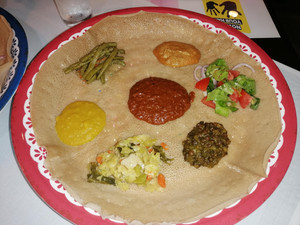 """Vegetables, bean stews, and salads on an Injera bread. Ethiopia is the best place on earth for """"fasting"""""""