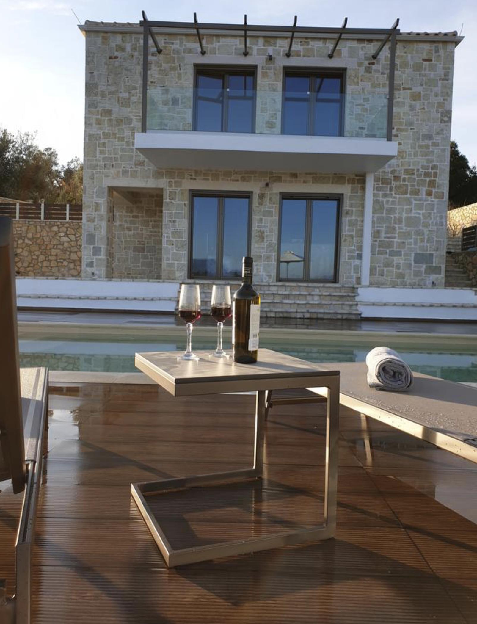 Twin Villas sunbeds and villa
