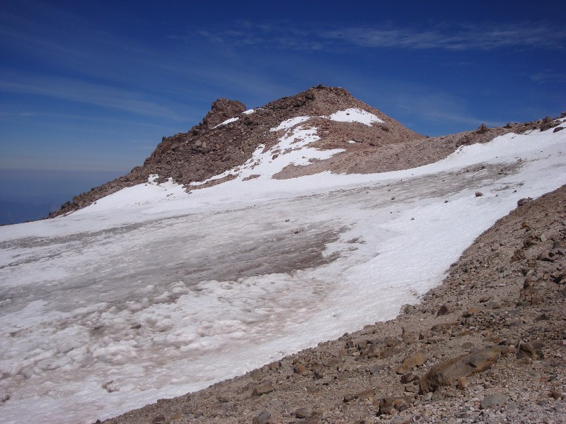 The false summit, with fumaroles dotting its cone.