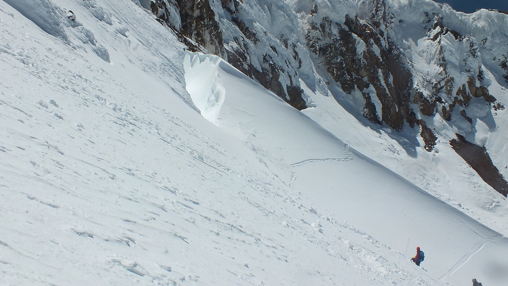 Here's the best photo of the crevasse I could get, with a few climbers included for scale.