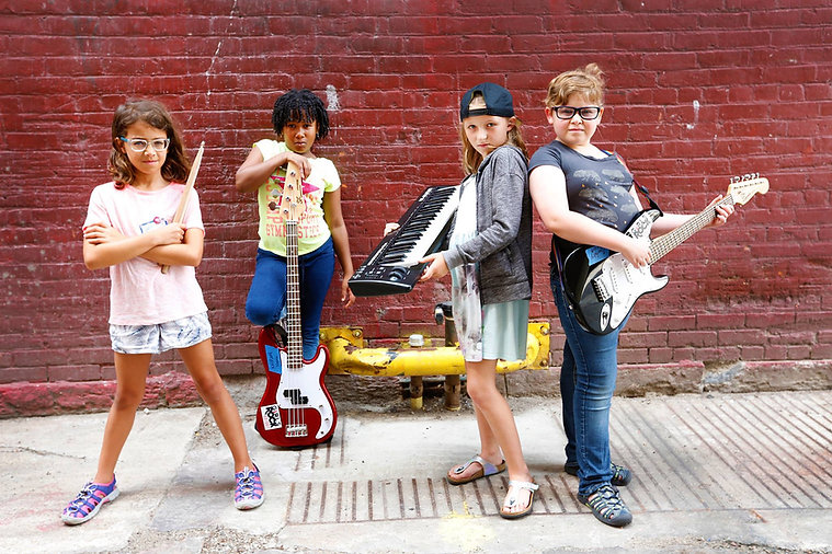 Blak Dragons band posing with instruments