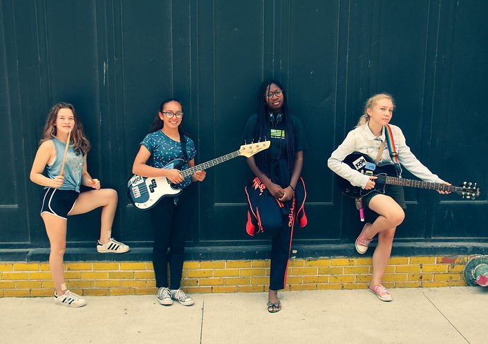 Campers posing with instruments