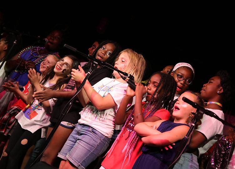Campers performing at Girls Rock Detroit Showcase