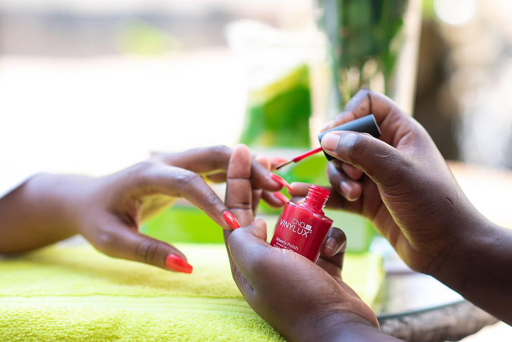 Woman getting her nails painted