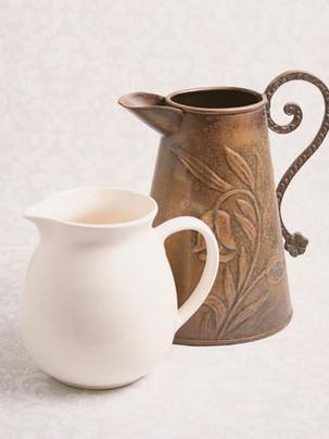 White jug & copper jug with floral motif