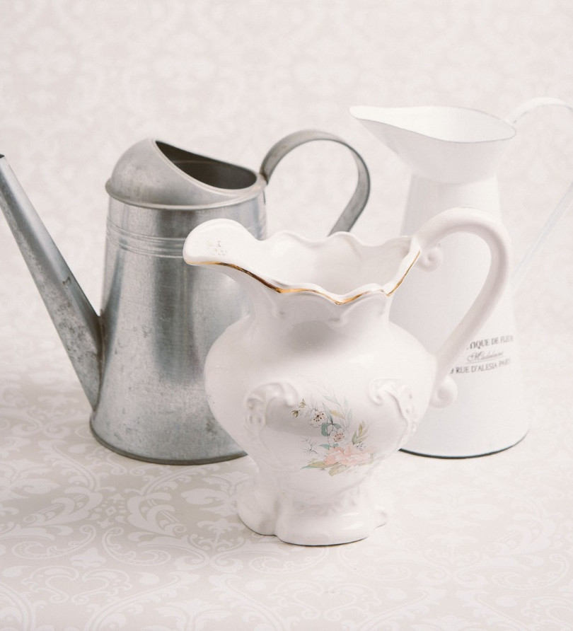 White ceramic jug, white metal pitcher and mini metal watering can