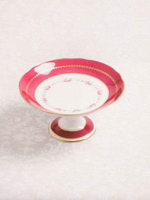 Pink and white ceramic cake stand with gold detailing