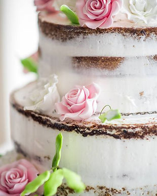 Naked wedding cake with pink and white f