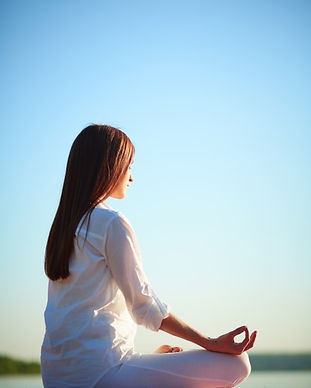 young-woman-practicing-meditation_1098-1