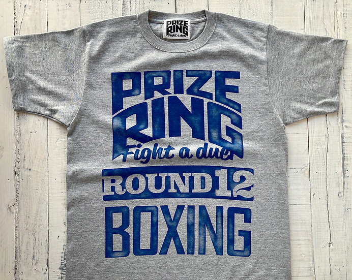 """Round 12"" TEE"
