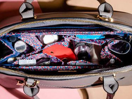 Toothbrushes In A Purse