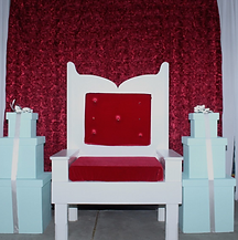 Red Chair with Red Rosette Backdrop.png