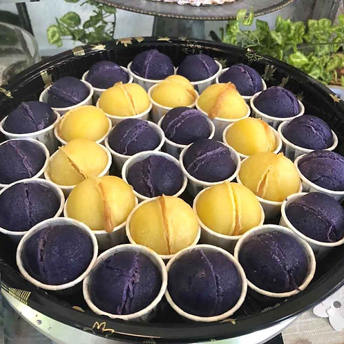 A platter full of butter and ube flavored mochi cake balls.