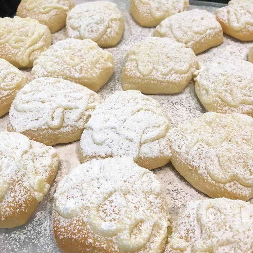 Rows of Cream Cheese Pillow Bread dusted with powdered sugar.
