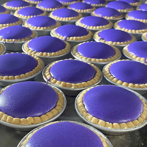 Rows of ube-flavored purple cheese tarts.
