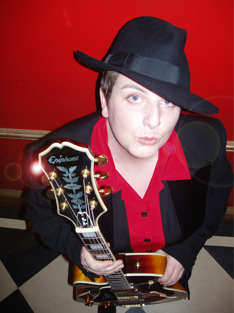 nicky_guitar_reverse_web copy.jpg
