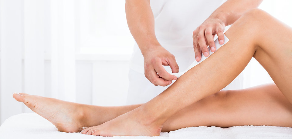 Close-up%20Of%20A%20Beautician%20Waxing%20Woman's%20Leg%20In%20Beauty%20Spa_edited.jpg