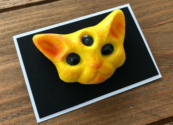 Yellow cat pin badge