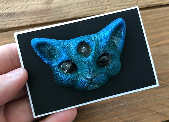 blue demon cat badge