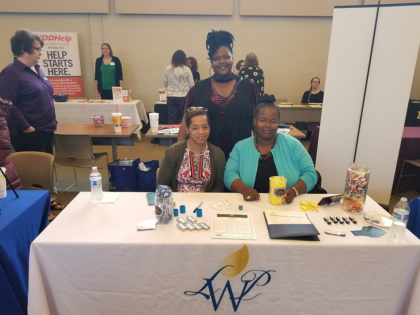 Provider Fair Staff and table pic.jpeg