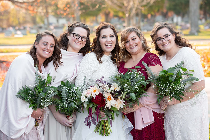bridesmaids with different color dresses