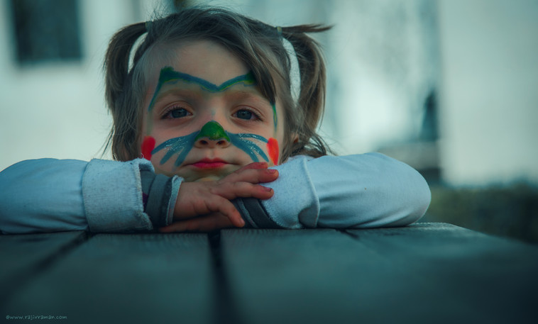 A Syrian child with her face painted.