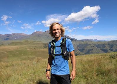 Pierre Jordaan in front of mountains runner