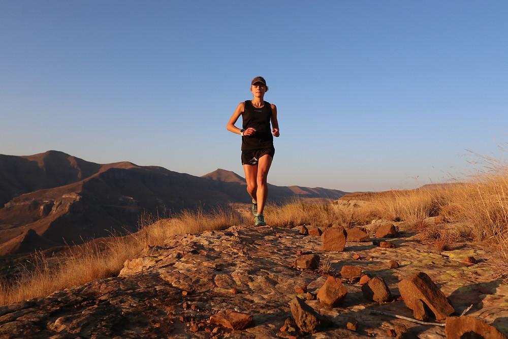 Nicolette Griffioen female mountain runner running along mountain trails
