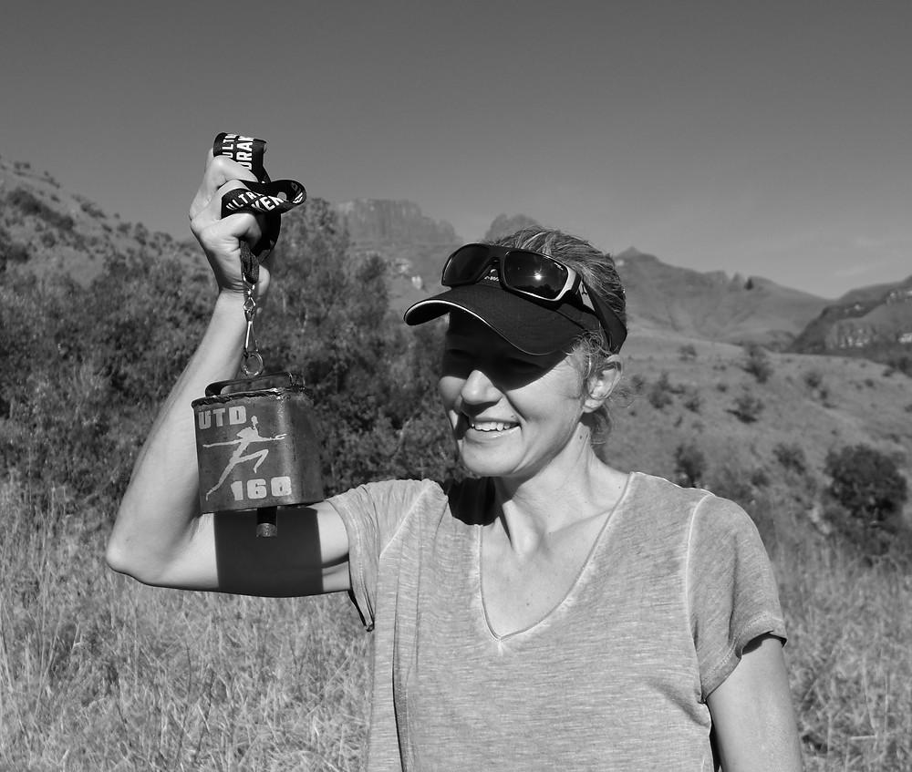 Mountain runner with UTD160 100miler cow bell