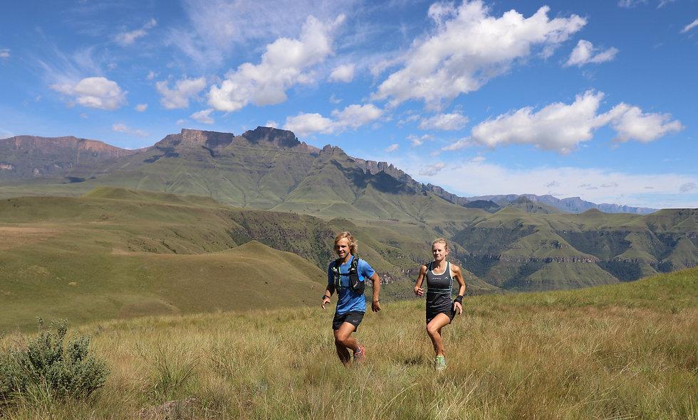 Two Inov8 mountain runners in the Drakensberg