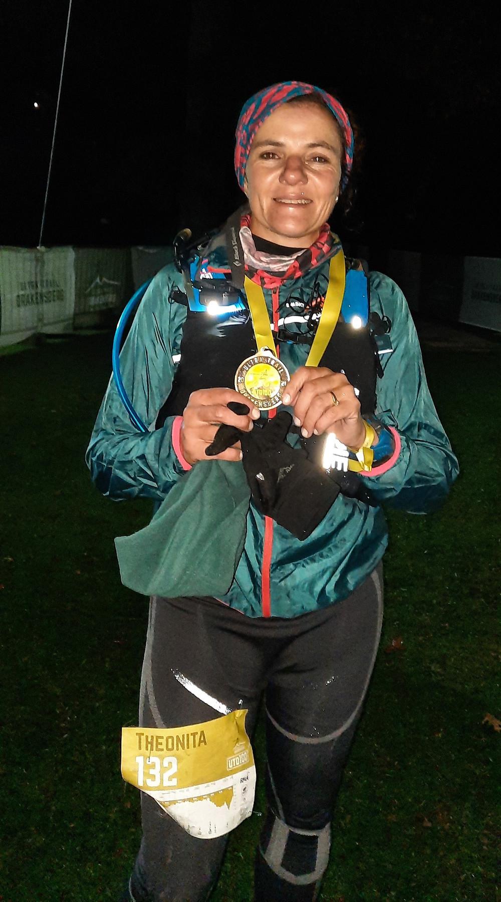 Female ultra runner with medal